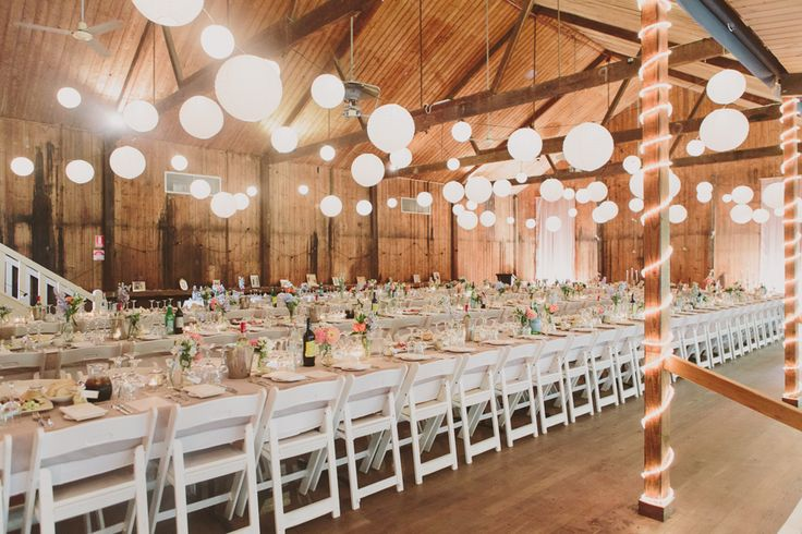 barn wedding with kings tables