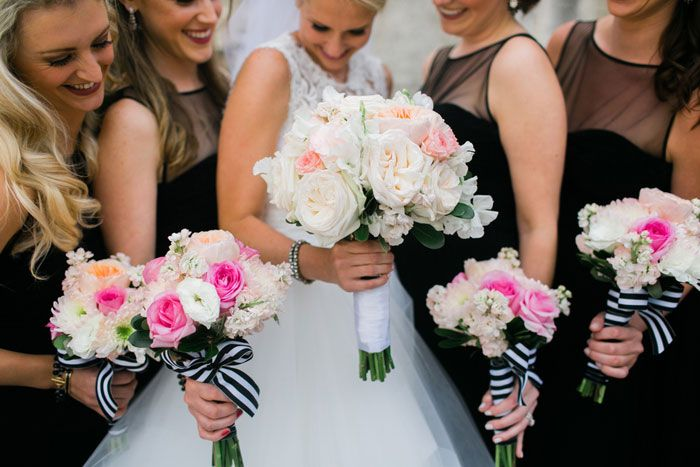 black bridesmaids dresses and flowers with striped ribbon