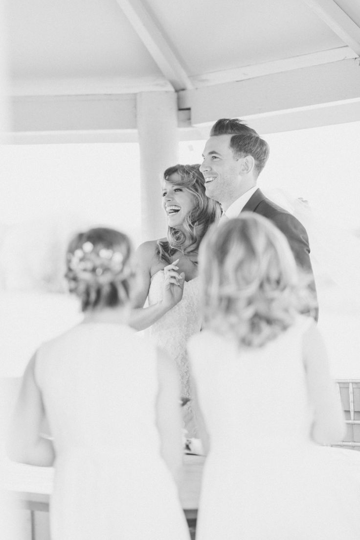 bride and groom laughing at a wedding
