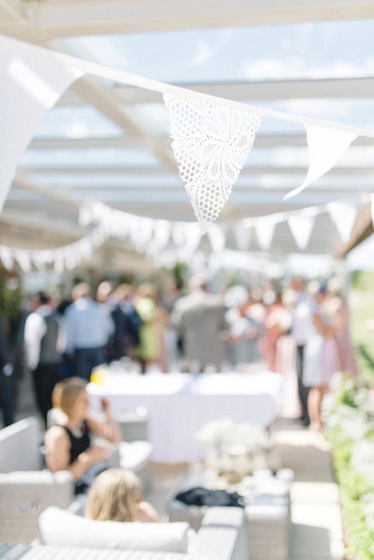 white triangle flags at a wedding