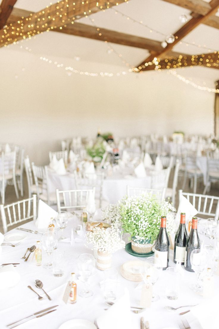 white wedding tables with baby's breath