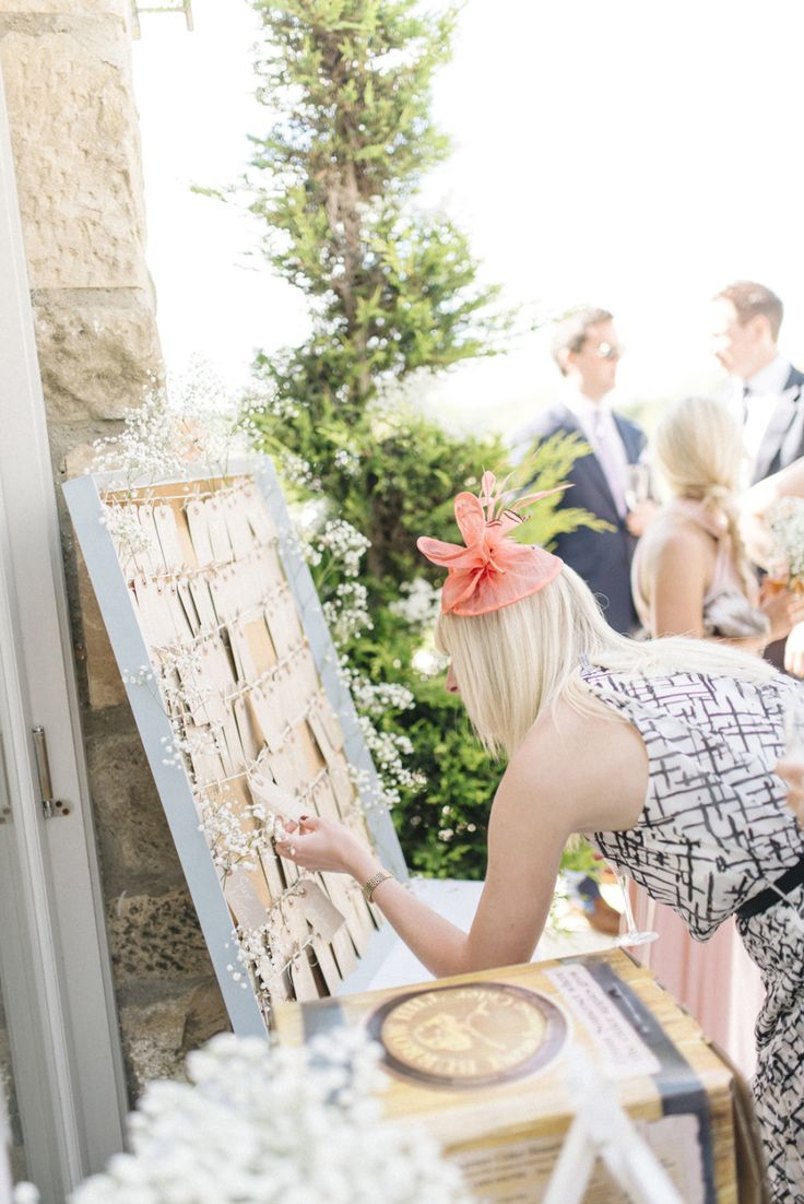 wedding guests looking at place cards