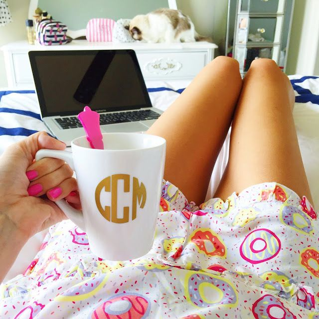 girl online shopping with a coffee and cute pajamas