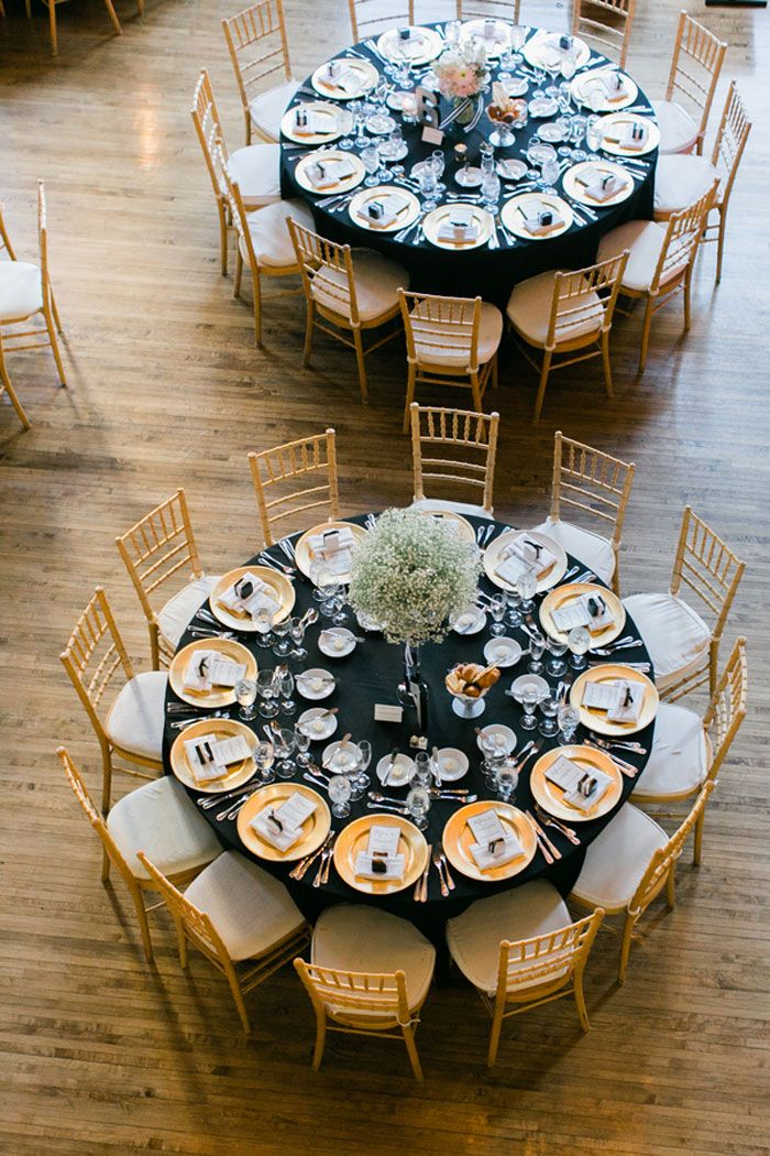 black table linens and gold wedding reception chairs