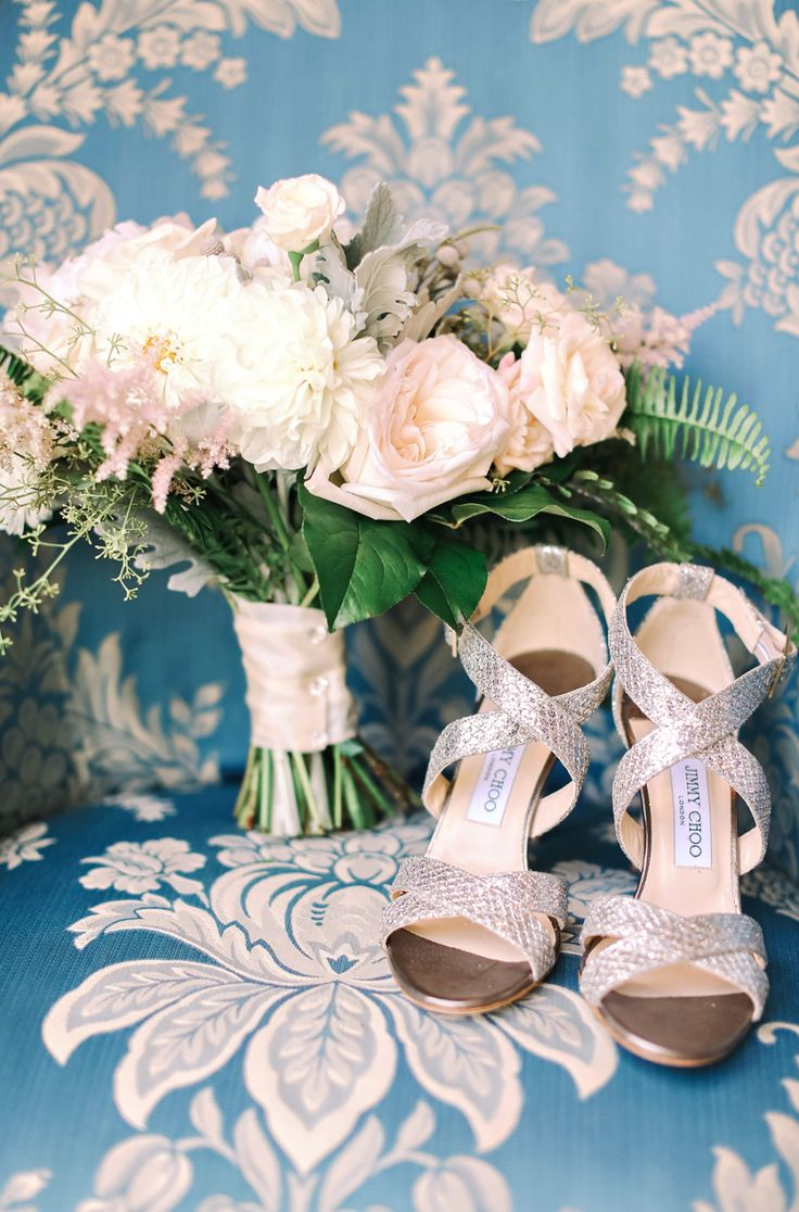 silver jimmy choo wedding sandals next to bridal bouquet