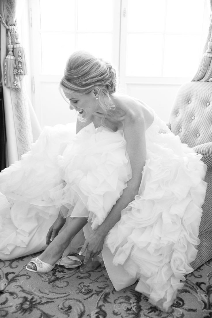 bride putting on Ivanka Trumps wedding shoes