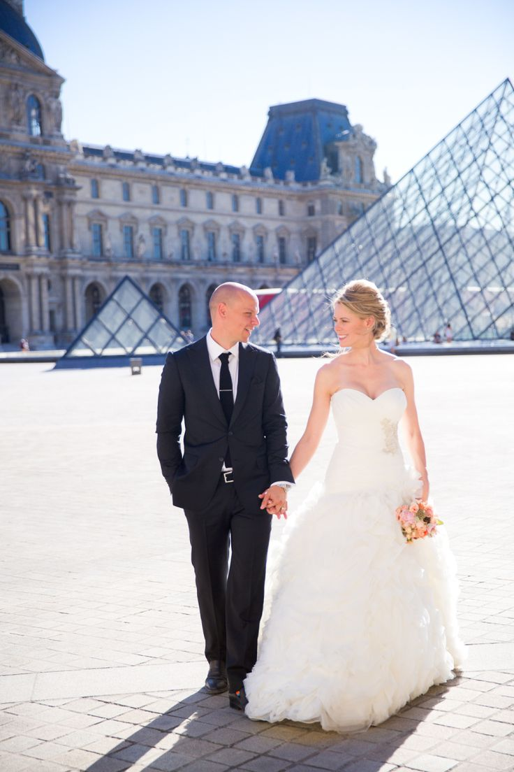 bride and groom walking by Paris landmarks
