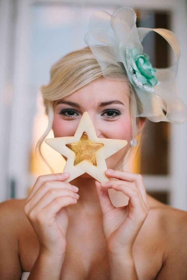 bridesmaid with large side bow holding a star cookie