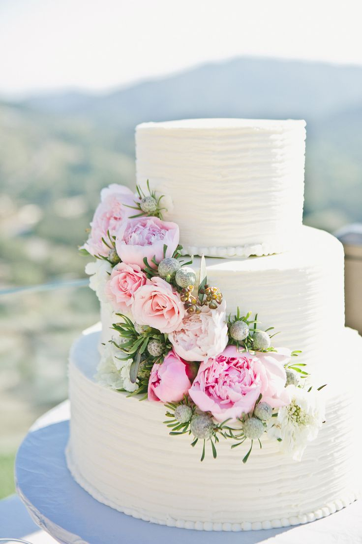 white cake with peonies