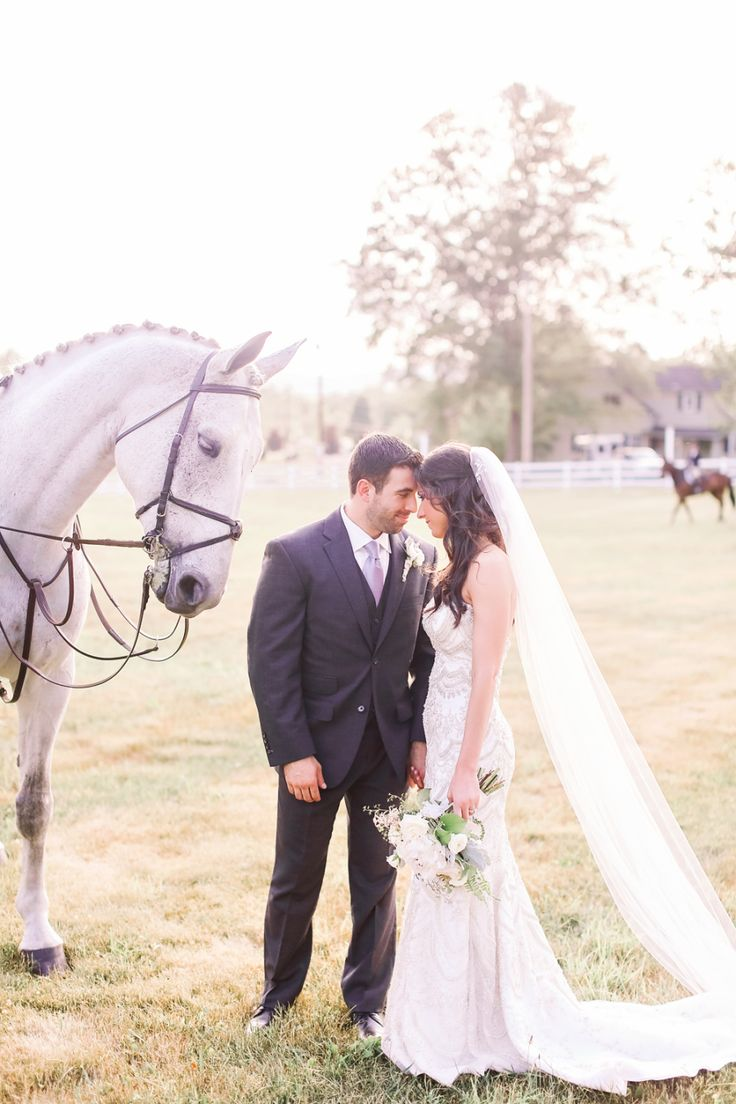 bride and groom standing next to house, equestrian weddings