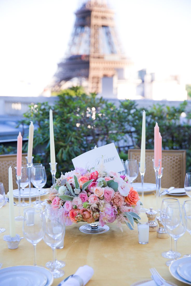 gorgeous low wedding reception flower display and Eiffel tower in backdrop