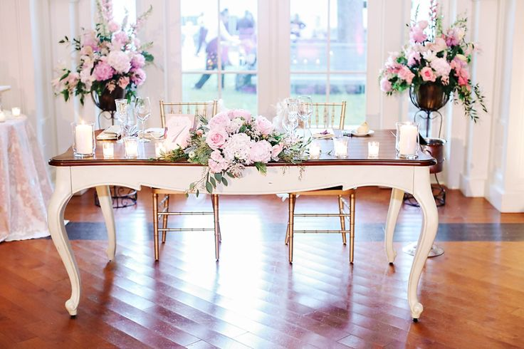 bride and groom sweatheart table
