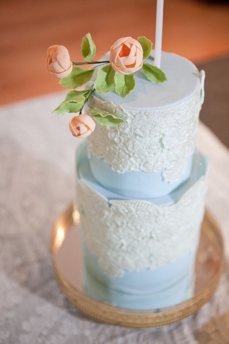 powder blue cake with white lace detail