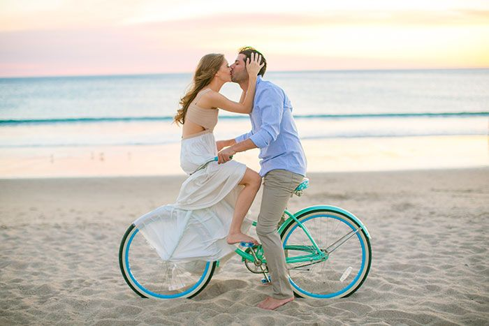 couple kissing on a beach cruiser on the beach, stylish engagement session