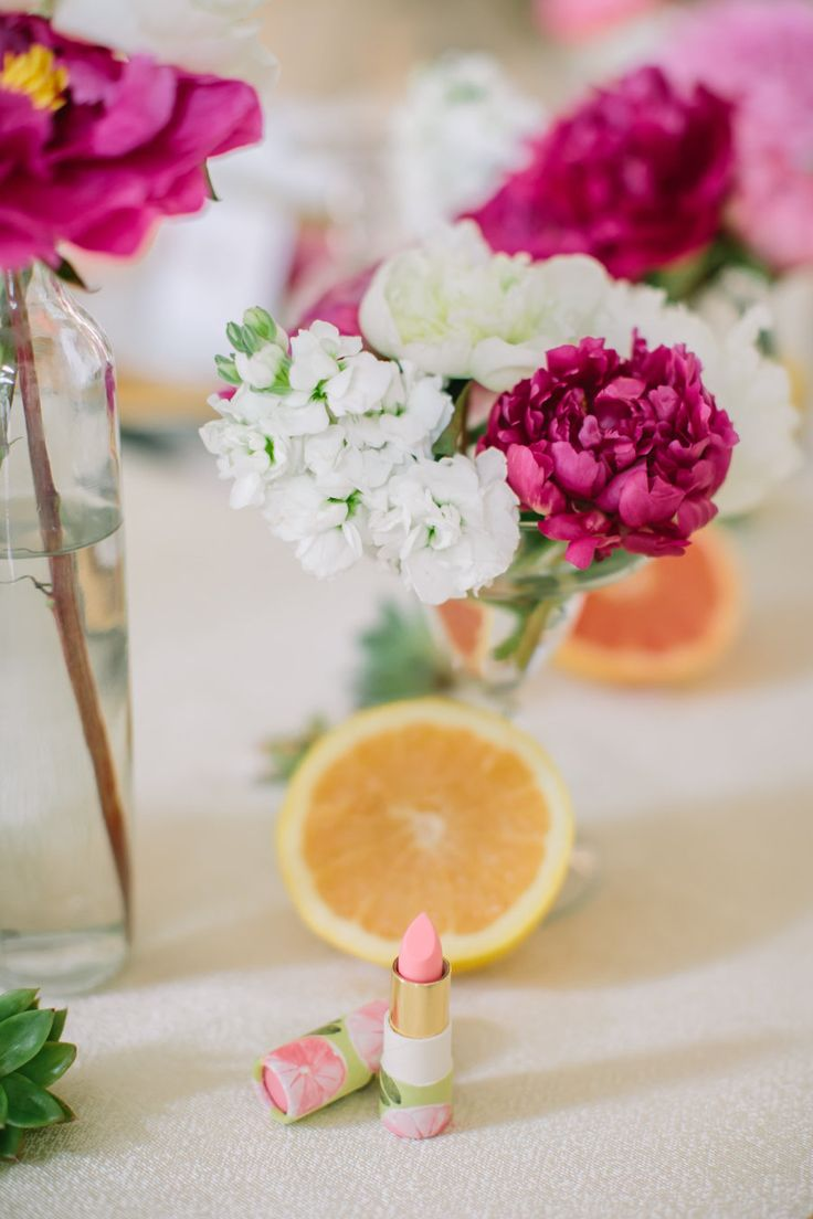pink and white peonies and oranges on a bridal shower table