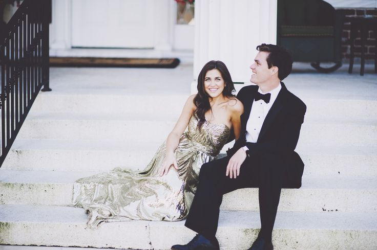 girl in gold strapless dress and guy in tux for engagement session