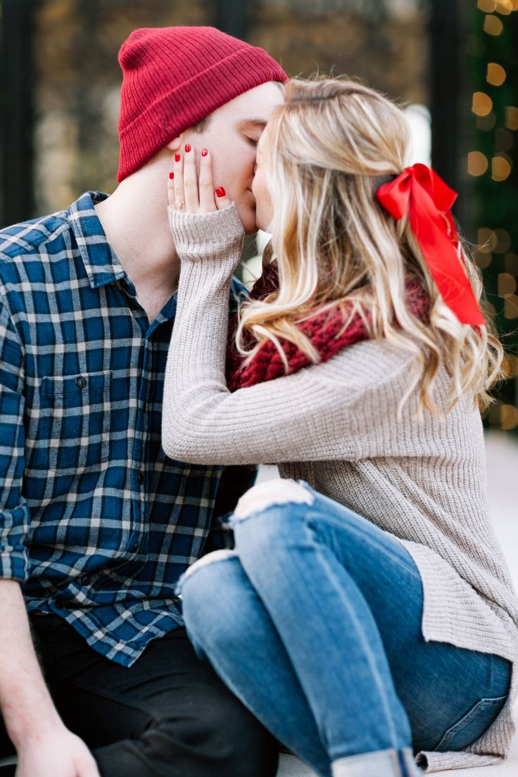 couple kiss during Christmas themed engagement session