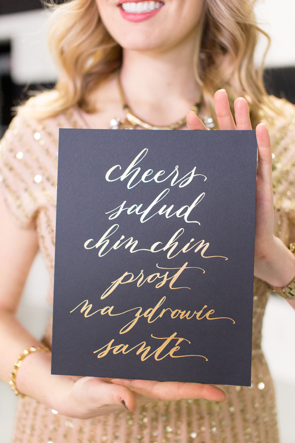 girl holding modern menu card with gold writing