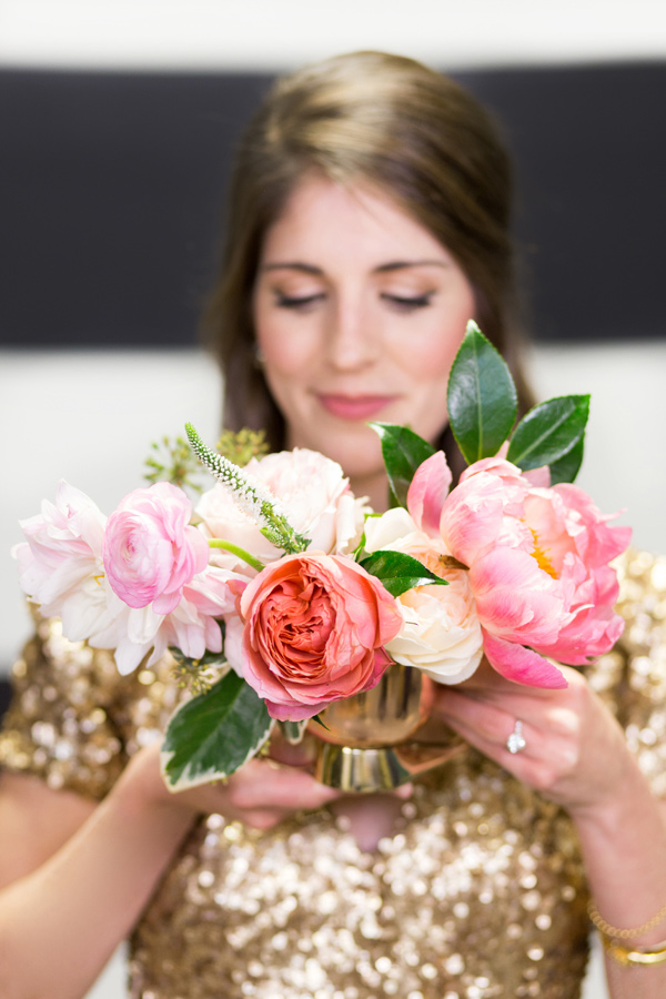 girl in gold dress holding bouquet