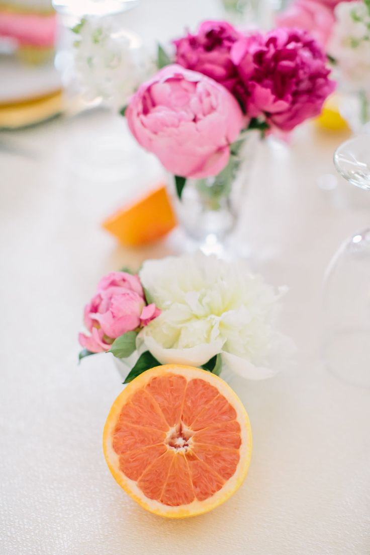 pink peonies and slices orange on tablescape