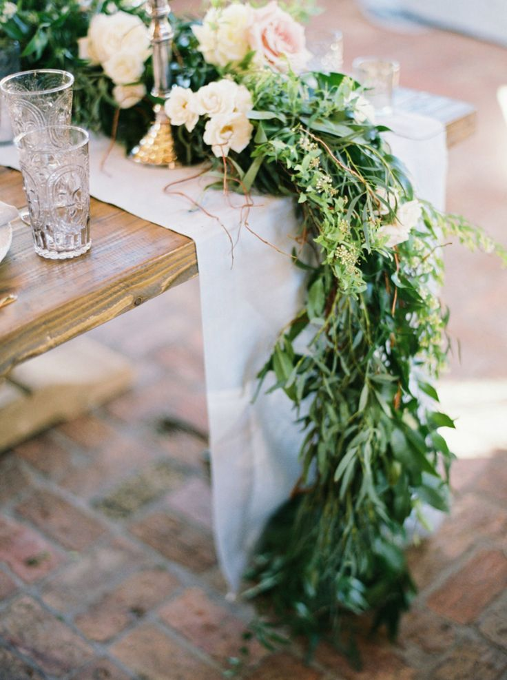 greenery and roses as wedding reception centerpiece
