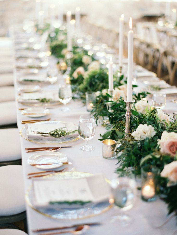 blue wedding linens with greenery and white roses