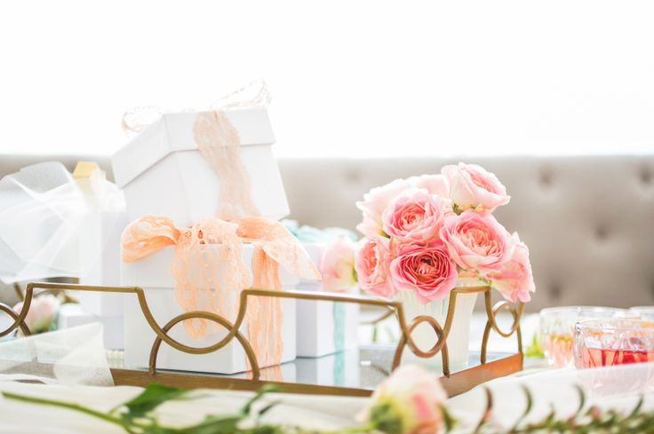 bridal shower gifts on gold bar cart