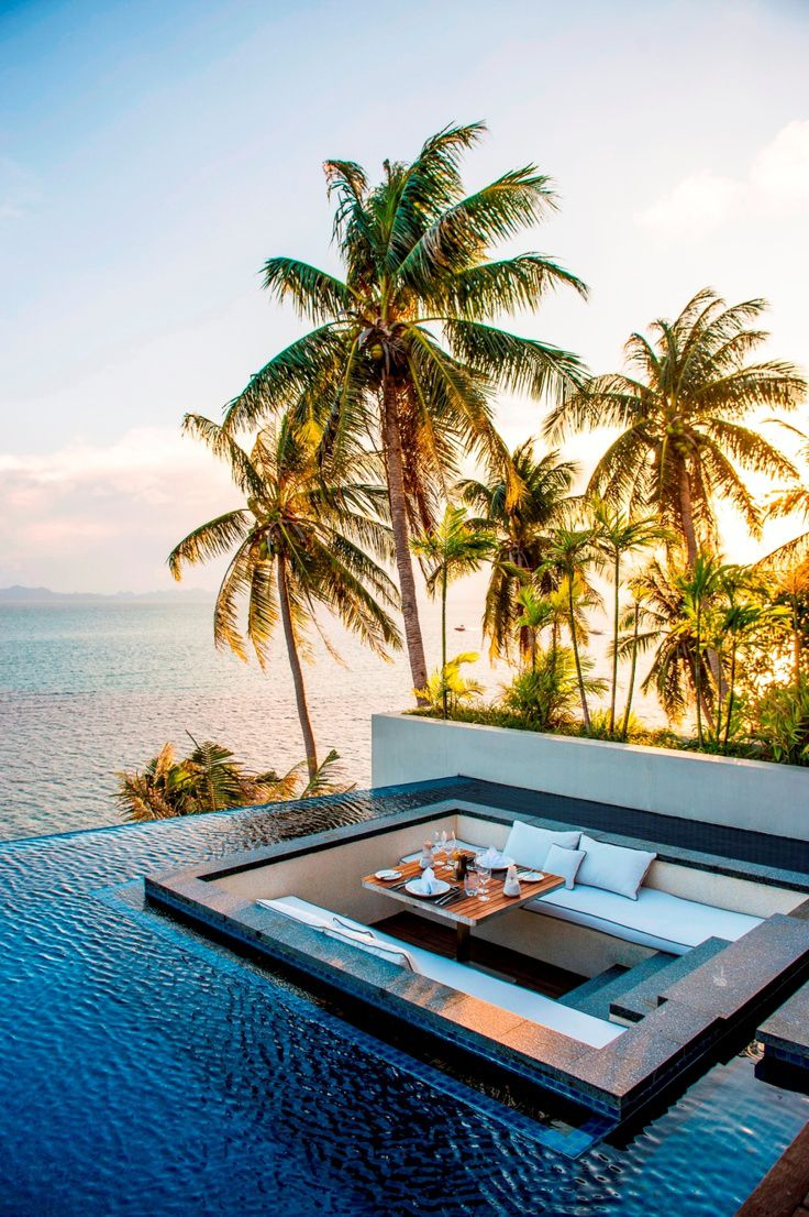 dreamy honeymoon destinations, table in a pool