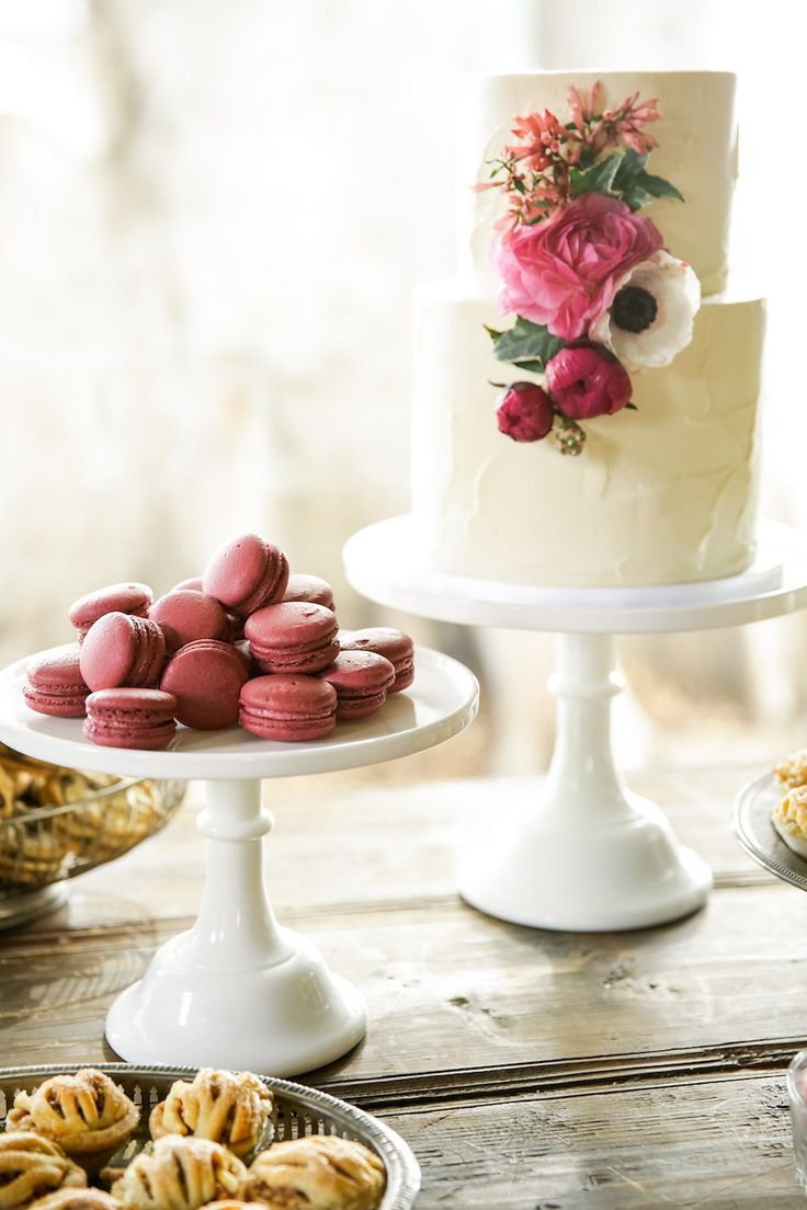 two tier wedding cake with burgundy macaroons