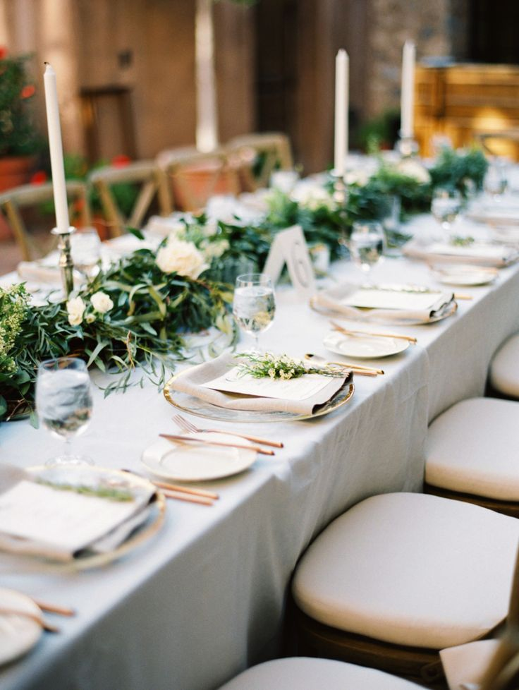 light blue wedding linens with greenery and white roses