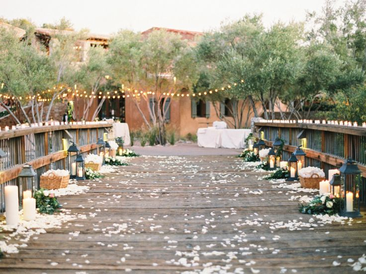 wedding decor on bridge with candles and rose petals