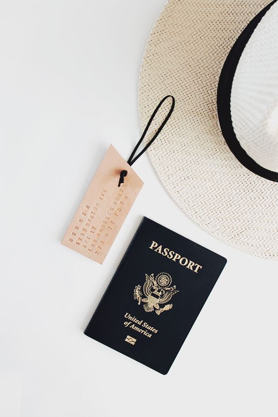 floppy hat, luggage tag and passport