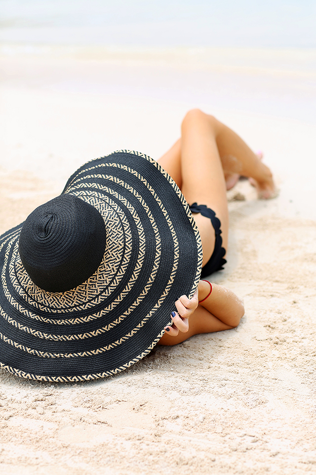 huge black sun hat, girl on honeymoon