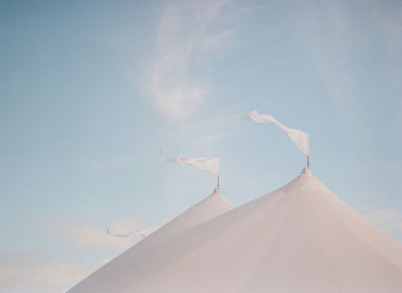 top of white marquee tents