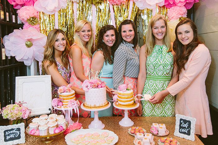 bridesmaids-pulling-out-charms-from-a-cake-pull