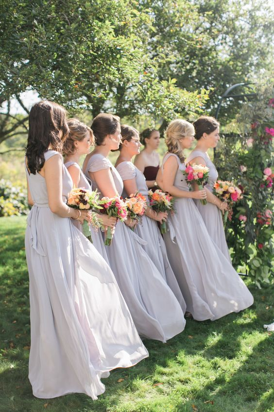 long purple bridesmaids dresses and colorful flowers