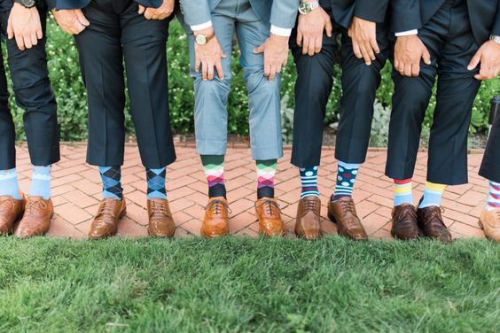 groomsmen showing off their socks