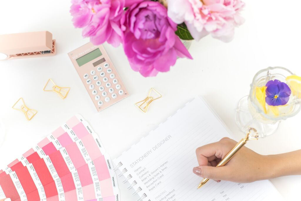 girl planning her wedding, getting organized with wedding planning book