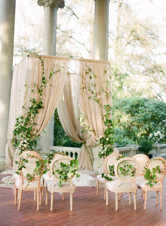 greenery on wedding ceremony chairs