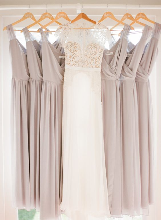hanging purple bridesmaids dresses