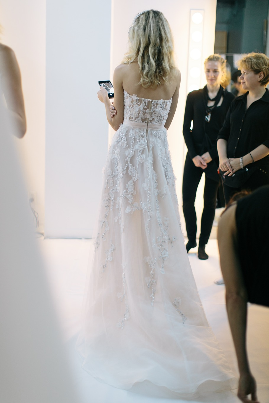 model checking her phone before bridal fashion show