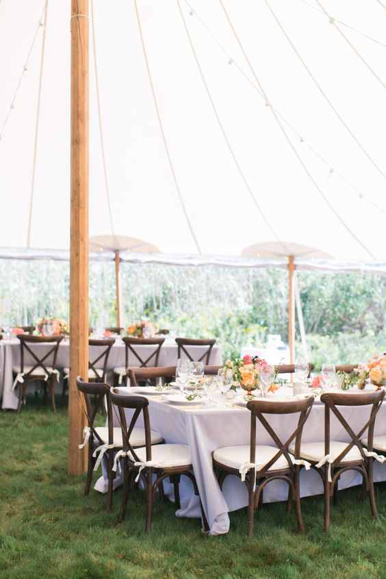 purple wedding linens under a marquee tent