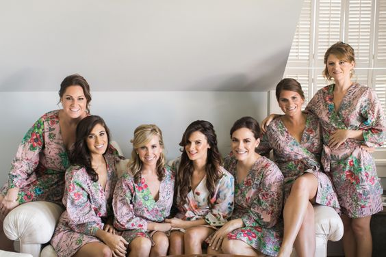 bridesmaids in matching plum pretty sugar robes