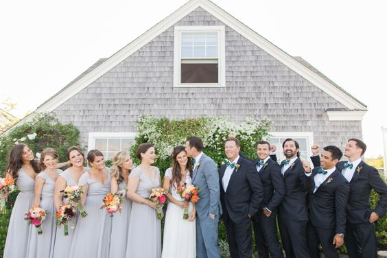 formal bridal party shots against a home