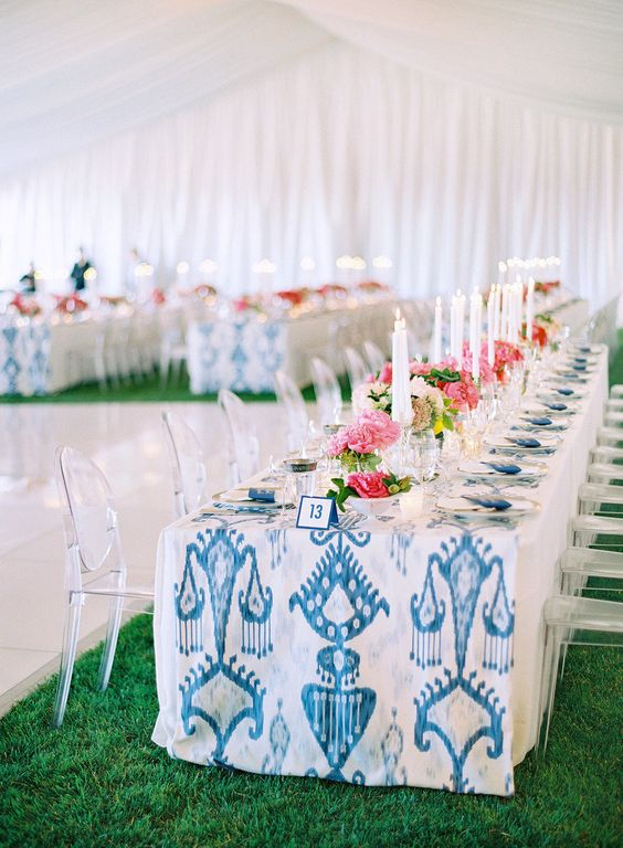 modern wedding kings tables with print table runner and pink flowers