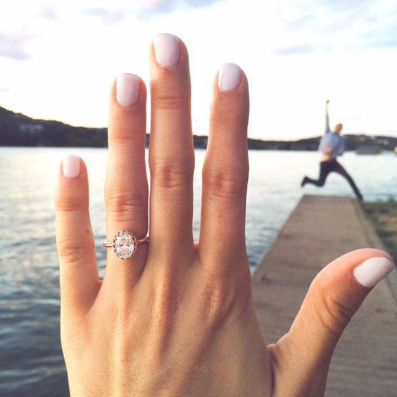 engagement ring selfie with finance jumping on the backdrop