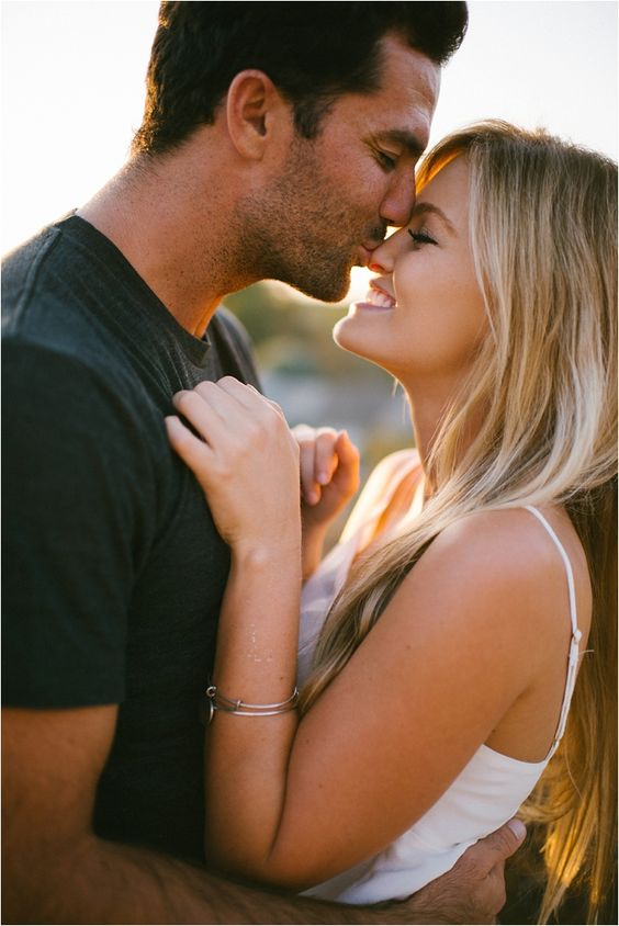 guy kissing fiance on the nose