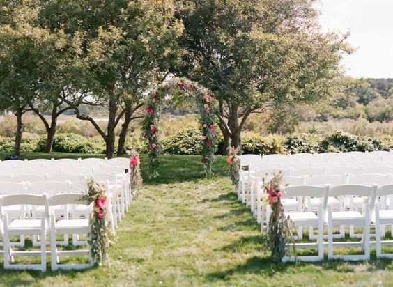 green and pink wedding arbor