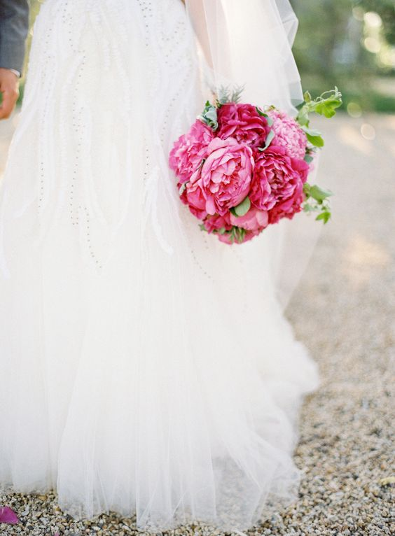 bride holding pink peonies bouquet