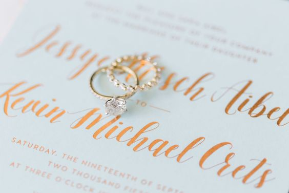 engagement rings on wedding invitation